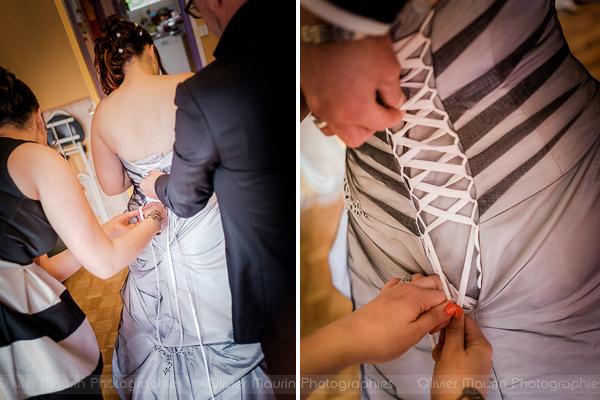 habillage de la mariée avec sa robe
